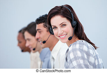 Attractive business woman and her team working in a call...