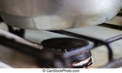 Ignition of the gas in the burner on the stove lighter. -...