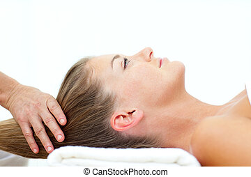 Blond woman enjoying a hair massage in a spa center