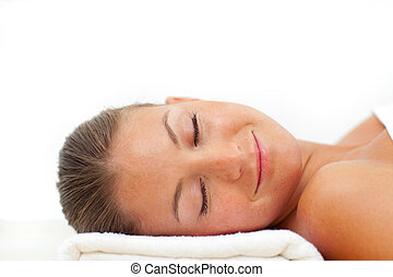 Portrait of smiling woman relaxing after a spa treatment