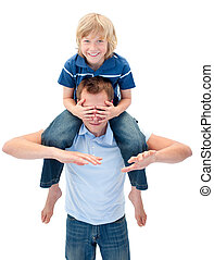 Joyful father giving his son piggyback ride against a white...
