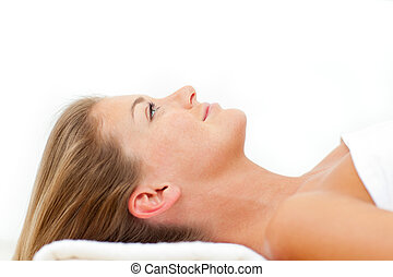 Portrait of calm woman relaxing after a spa treatment