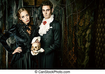 terrible couple - Beautiful man and woman vampires dressed...