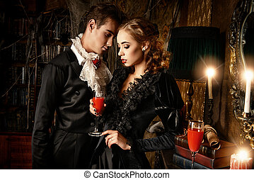 vampire love - Beautiful man and woman vampires dressed in...