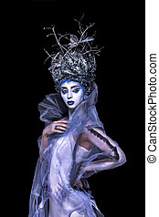 Young woman  with silver blue creative  artistic fantasy make-up, dress