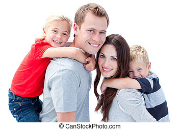 Portrait of joyful family enjoying piggyback ride against a...