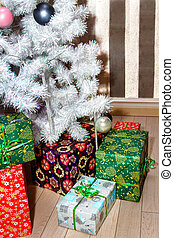 boxes with gifts under the Christmas tree - image boxes with...