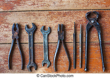 Preparing for home repairs - Older tools are laid out in a...