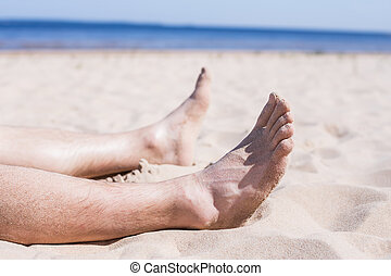 Rest from the problems - Men's feet on the background of a...