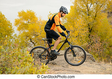 Cyclist Riding Bike on the Beautiful Autumn Mountain Trail -...
