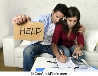 young couple worried at home in bad financial situation...