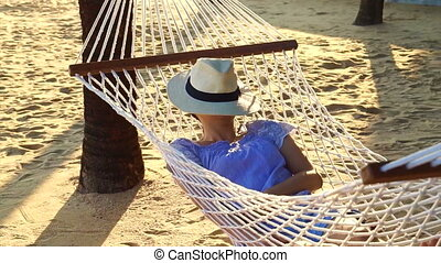 Asian woman hammock sunny beach
