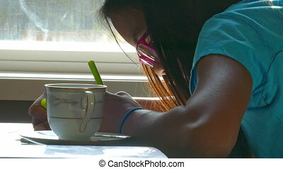 Asian Girl Drawing At The Table - A cute 13 year old Asian...