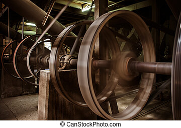 old heavy machine wheel working by hot steam in ancient...