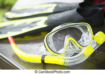yellow snorkelling mask and flipper, dive