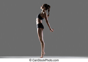Standing backbend exercise - Portrait of beautiful young...