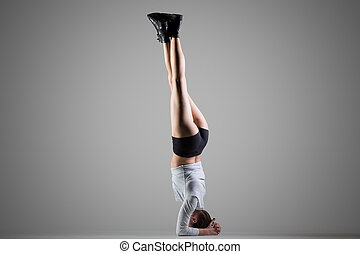 Side Headstand yoga pose - Cool attractive young fit woman...