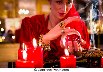 Soothsayer in Seance with Crystal ball and smoke -...