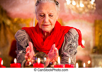 Soothsayer during esoteric session with Crystal ball -...