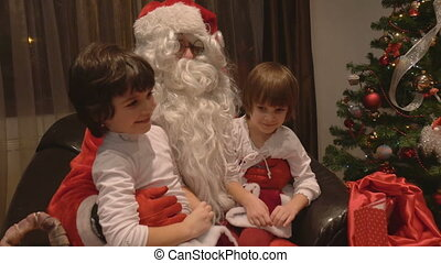 Girls sitting in Santa Claus Lap
