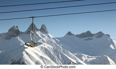 Skiers on French Alps - Skiers on chair lift in Le Corbier,...