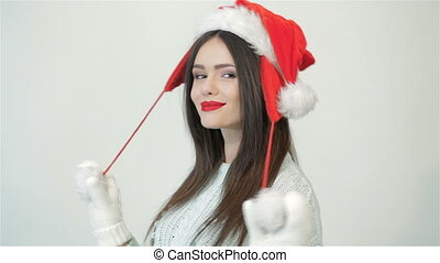 Beautiful woman with christmas hat is posing