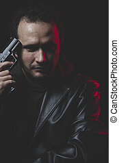 Unhappy, Man with intent to commit suicide, gun and leather jacket, red backlight