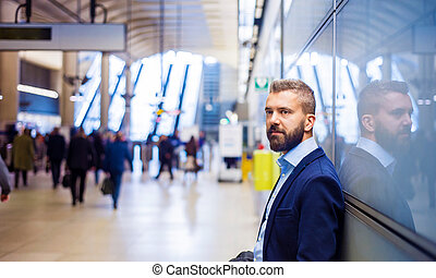 Businessman in subway - Young handsome businessman in subway...
