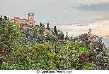 Castle and clock tower of Brisighella, Ravenna, Italy -...