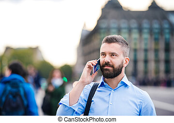 Man with smart phone - Handsome young man with smart phone...