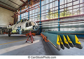 Helicopter repair stand in the hangar - Helicopter without...