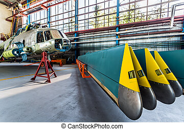 Helicopter rotor blades removed from aircraft Air transport...