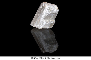 Optical calcite raw mineral stones with reflection on black...