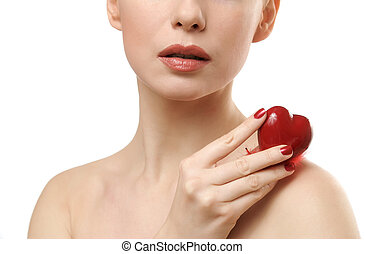 Beautiful woman holding red heart.