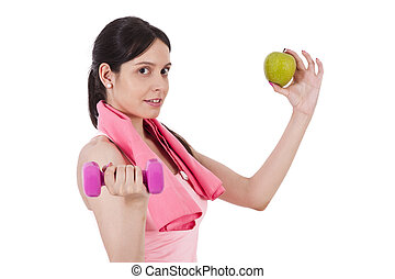 Girl with dumbbells and apple