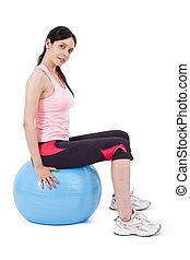 girl sitting on gym ball