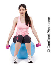 girl lifting weights in gym ball