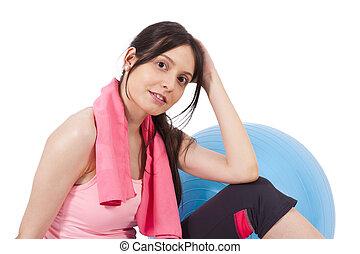 Girl with towel and gym ball