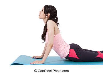 girl on mat doing back exercises