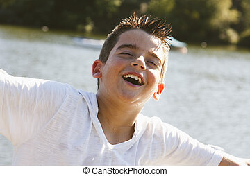 portrait of boy outdoors smiling