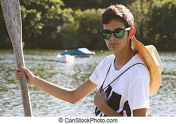 young teenage boy with oar