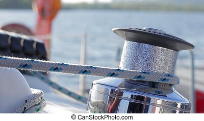 Tensioning sail yacht. Winch on sailing yacht. Raise the...