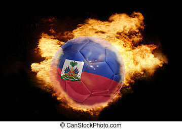 football ball with the flag of haiti on fire - football ball...