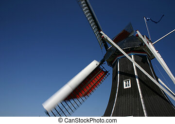 Windmill - a close up of a working dutch windmill in...