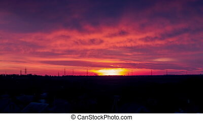 Sunrise over the horizon in the morning - Bright orange-red...