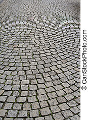 Old cobblestone pavement - Old European pavement with...