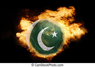 football ball with the flag of pakistan on fire - football...