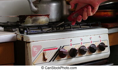 Ignition of the gas in the burner on the stove lighter.