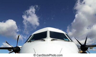 Cockpit, front cabin aircraft against the sky, time lapse