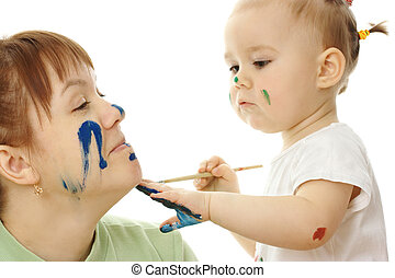 Little girl paint on her mother